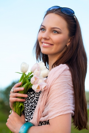 portrait of a young beautiful woman outdoors  photo