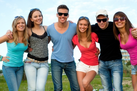 friends happy: portrait of large group of young people in summer time Stock Photo