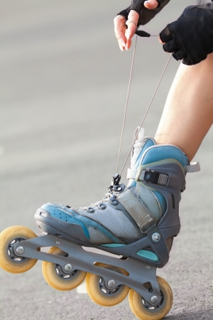 blading: Close-up Of Legs Wearing Roller Skating Shoe, Outdoors