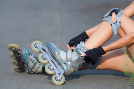 Close-up Of Legs Wearing Roller Skating Shoe, Outdoors