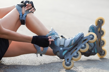 inline skating: Close-up Of Legs Wearing Roller Skating Shoe, Outdoors