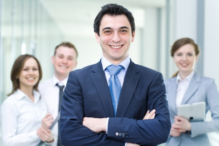 Successful businessman with colleagues in the background Stock Photo - 22026889