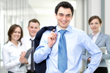Successful businessman with colleagues in the background Stock Photo - 22026890