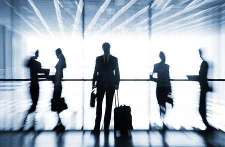 life partners: Several silhouettes of businesspeople interacting  background airport