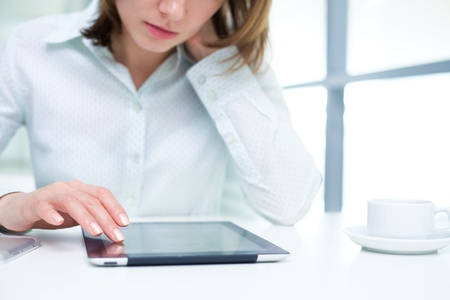 Young businesswoman holding a digital tablet Stock Photo