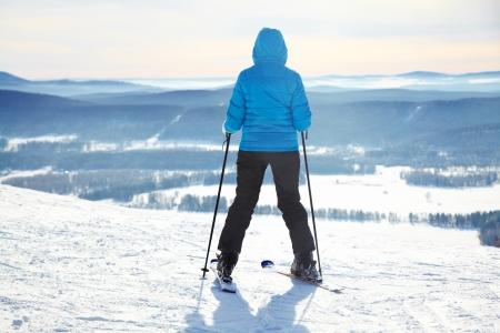 to ski: happy young woman on ski vacation