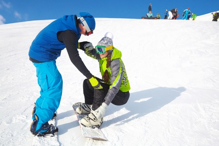 Lucky couple snowboarders in a mountain valley Stock Photo - 22360920