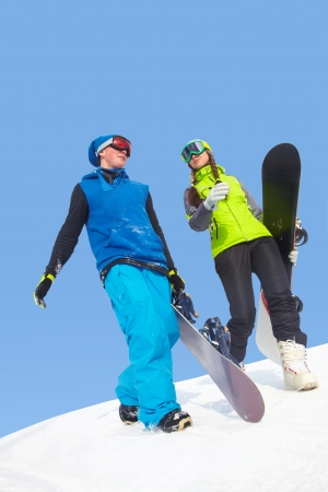 adventure holiday: Lucky couple snowboarders in a mountain valley