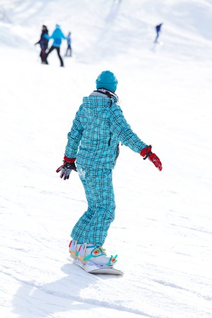 Lifestyle image of t young adult snowboard photo