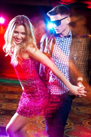 young couple having fun dancing at  party. photo