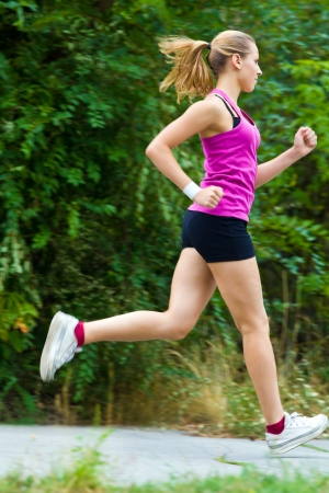 tenager: Young sports girl is running in park