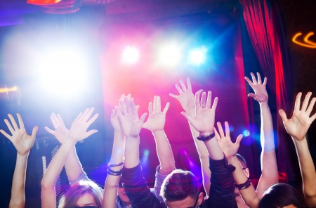 nightclub crowd: Many hands of the crowd at a youth disco