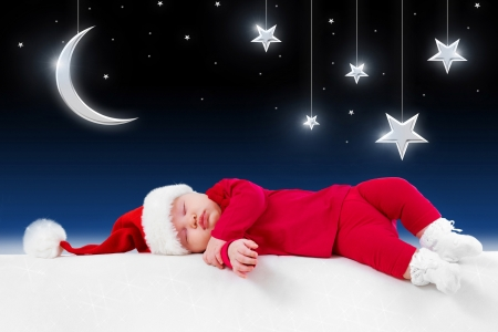 Christmas baby is sleeping on background fairy-tale night