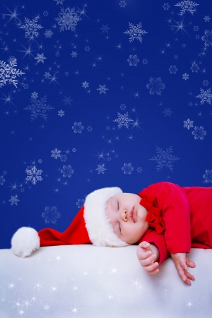 fairy-tale portrait of Christmas baby is sleeping on winter background