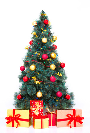 Traditional Christmas tree with baubles and gifts on white photo