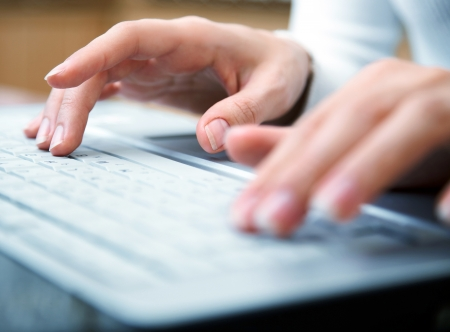 Female hands typing on a laptop  photo