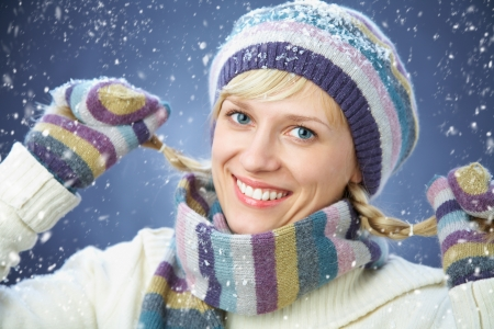 Winter portrait of beautiful smiling woman with snowflakes photo
