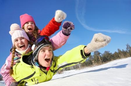 Group of  teenagers slide downhill in wintertime Standard-Bild