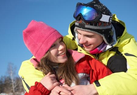 Loving  couple having fun on a beautiful winter day photo