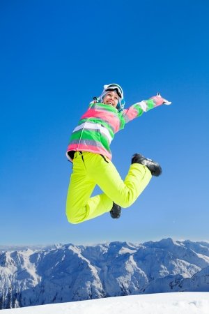 Young  woman enjoy rest on ski holiday in mountains