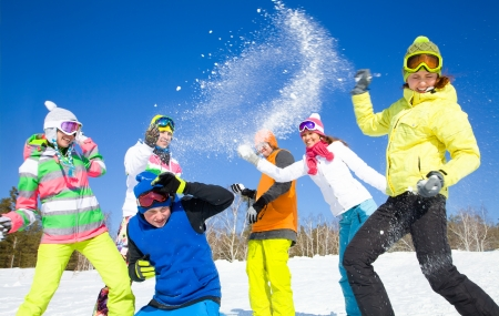 snow ski: group of friends have a snowball fight