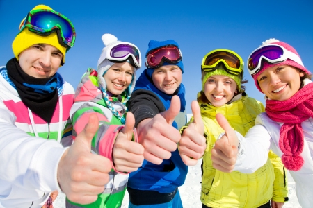 ski resort: Group of young people on ski holiday in mountains