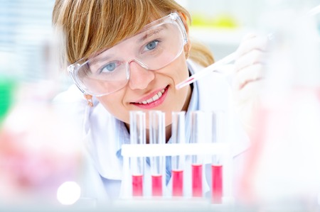 Medical  researcher  using looking at a solution in a laboratory photo