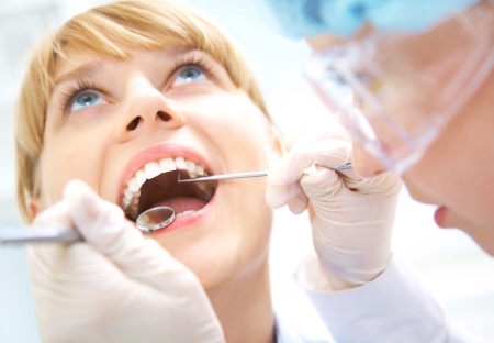 Female teeth being checked by doctor