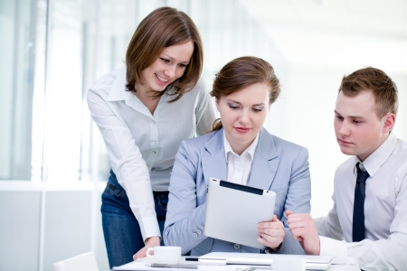 Contemporary business people working in team in the office Standard-Bild