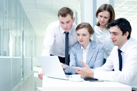 Contemporary business people working in team in the office Banco de Imagens