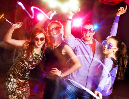 new year dance: Group of young people having fun dancing at  party. Stock Photo