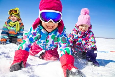 Group of children playing on snow in winter time Standard-Bild