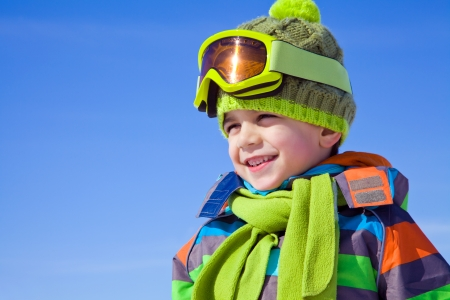 Portrait of little boy in winter  clothes outdoor in wintertime photo