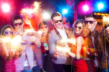 celebration party: young company celebrates the holiday with fireworks in the hands