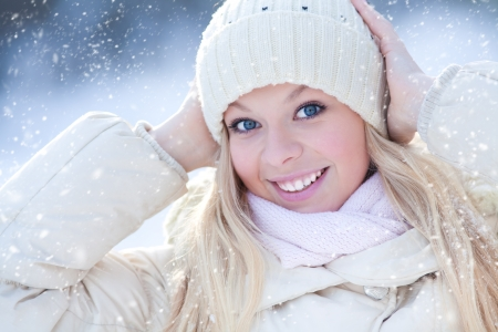 Portrait of blond young woman in winter photo