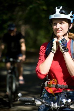 woman cyclist on a mountain bike  photo