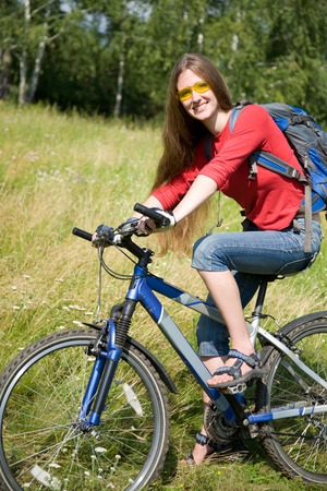 young woman on bicycle  rides from green  park photo