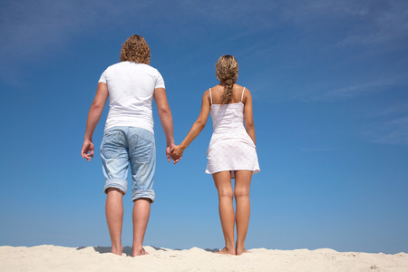 courtship: Young attractive couple at the beach Stock Photo