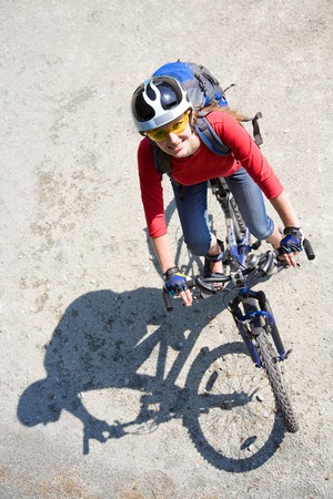 Young cyclist on a mountain bike  in the park photo