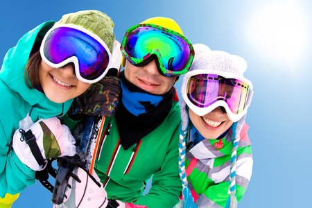 cheerful young friends in winter sportswear ski resort photo