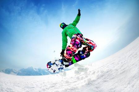 snowboarder jumping from the mountaint along the road extreme Standard-Bild