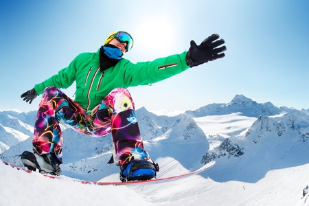 snowboarder slides from the mountaint along the road extreme Stock Photo - 26465041