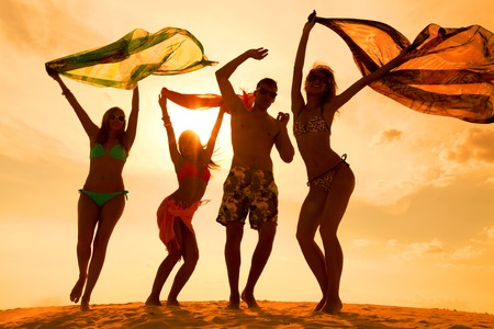 Large group of young people enjoying a beach party Stock Photo - 26659981