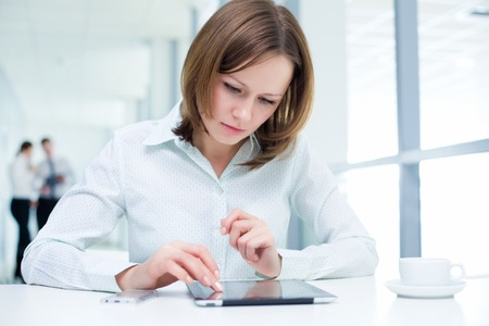 Young businesswoman holding a digital tablet photo