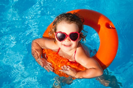 little girl in swimming pool photo