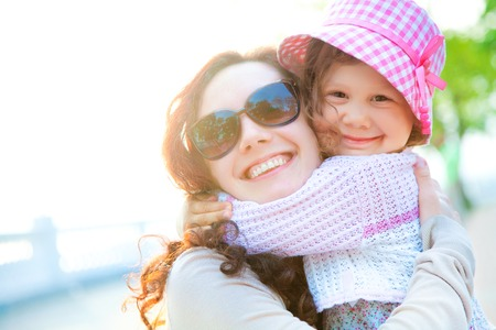 little girl and her mother have a good summer time Stock Photo - 27439228