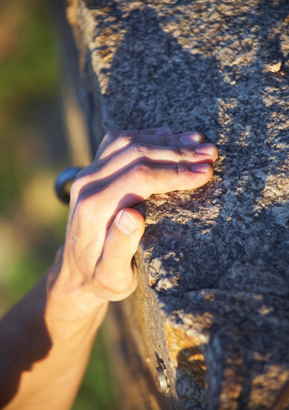handhold: Rock climbers hand on handhold Stock Photo