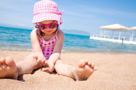 little cute girl have a happy summer time on the beach photo