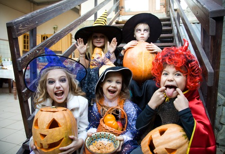 halloween: children curve faces in fairy costume on holiday halloween
