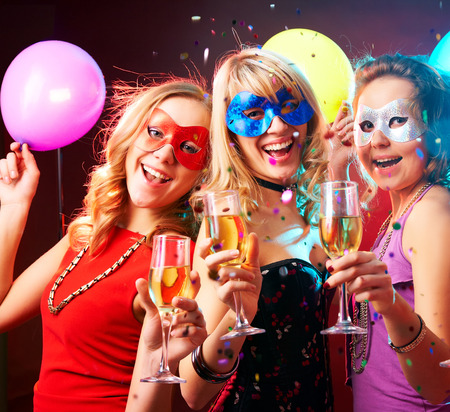 Dance happy young girls under masks on the party